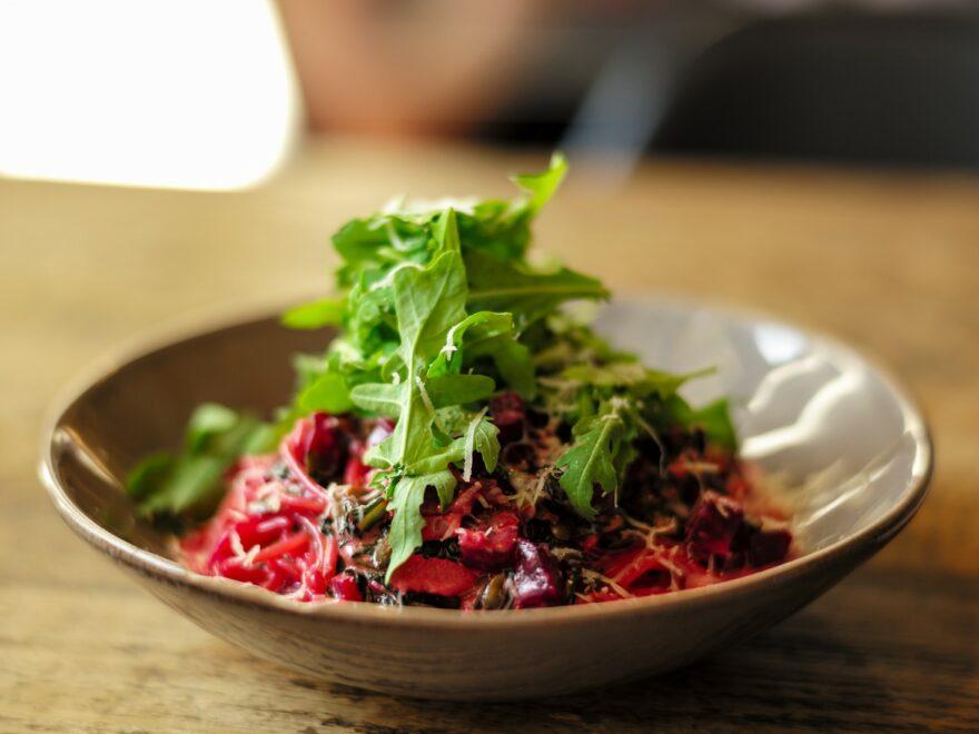 vegetable salad on brown ceramic bowl